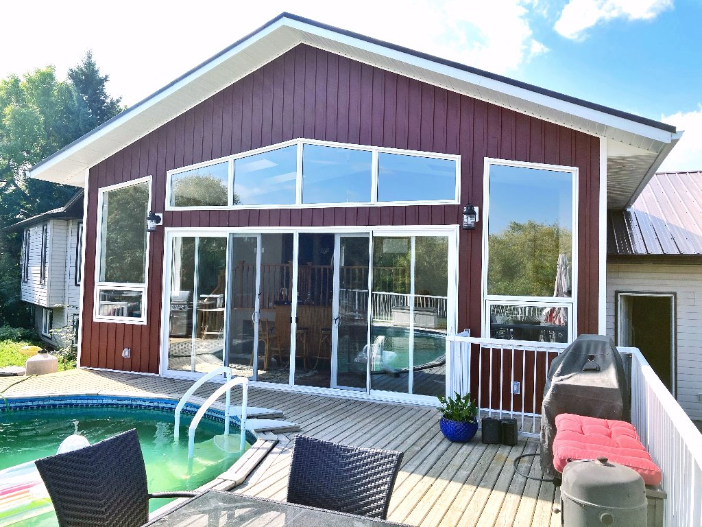 windows, doors, overhead doors, roofing and siding